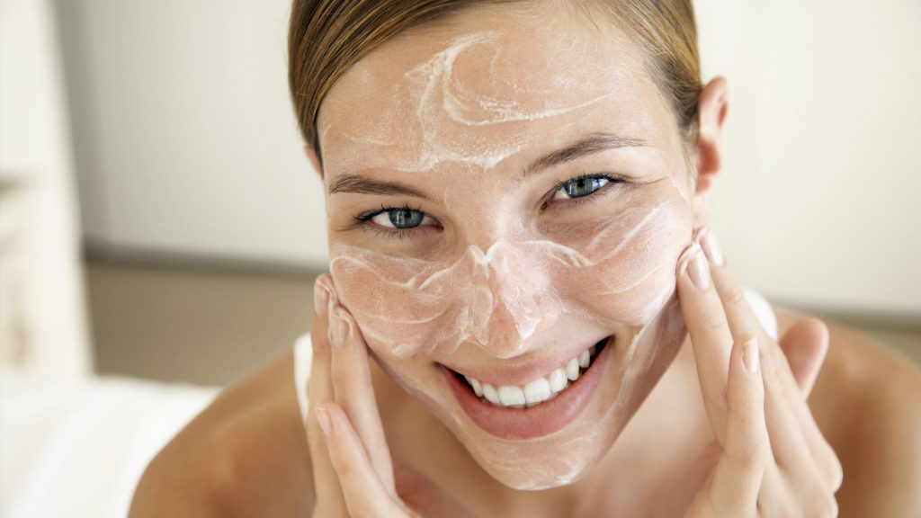 woman-applying-cream